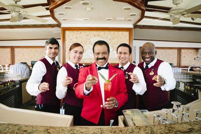 "Ted Lange, who played the bartender on The Love Boat, shows off his new cocktail fittingly called ""The Isaac"" that will debut aboard Princess Cruises' ships on Valentine's Day."