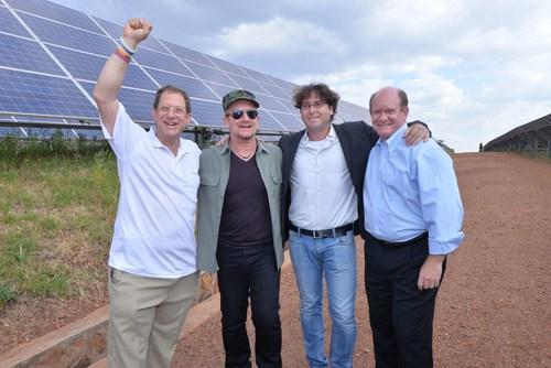 U2's Bono with Gigawatt Global co-founders Yosef Abramowitz and Chaim Motzen, plus Electrify Africa Act co-sponsor US Senator Chris Coons at East Africa's first solar field near Kigali, Rwanda. Bono and Abramowitz are both Nobel Prize candidates for 2015. (PRNewsFoto/Gigawatt Global) (PRNewsFoto/Gigawatt Global)