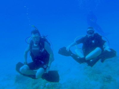 Wounded veterans dive near the Sea Tiger, a sunken ship off the coast of Oahu