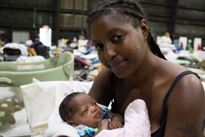 Vernesha and her 3-week-old baby niece, Joy, are staying at a shelter in Baton Rouge after being driven from their home by rising floodwaters on Saturday, Aug. 13. They live together with Joy's mother and two older sisters in an apartment that is now underwater. Photo by Stuart Sia / Save the Children.