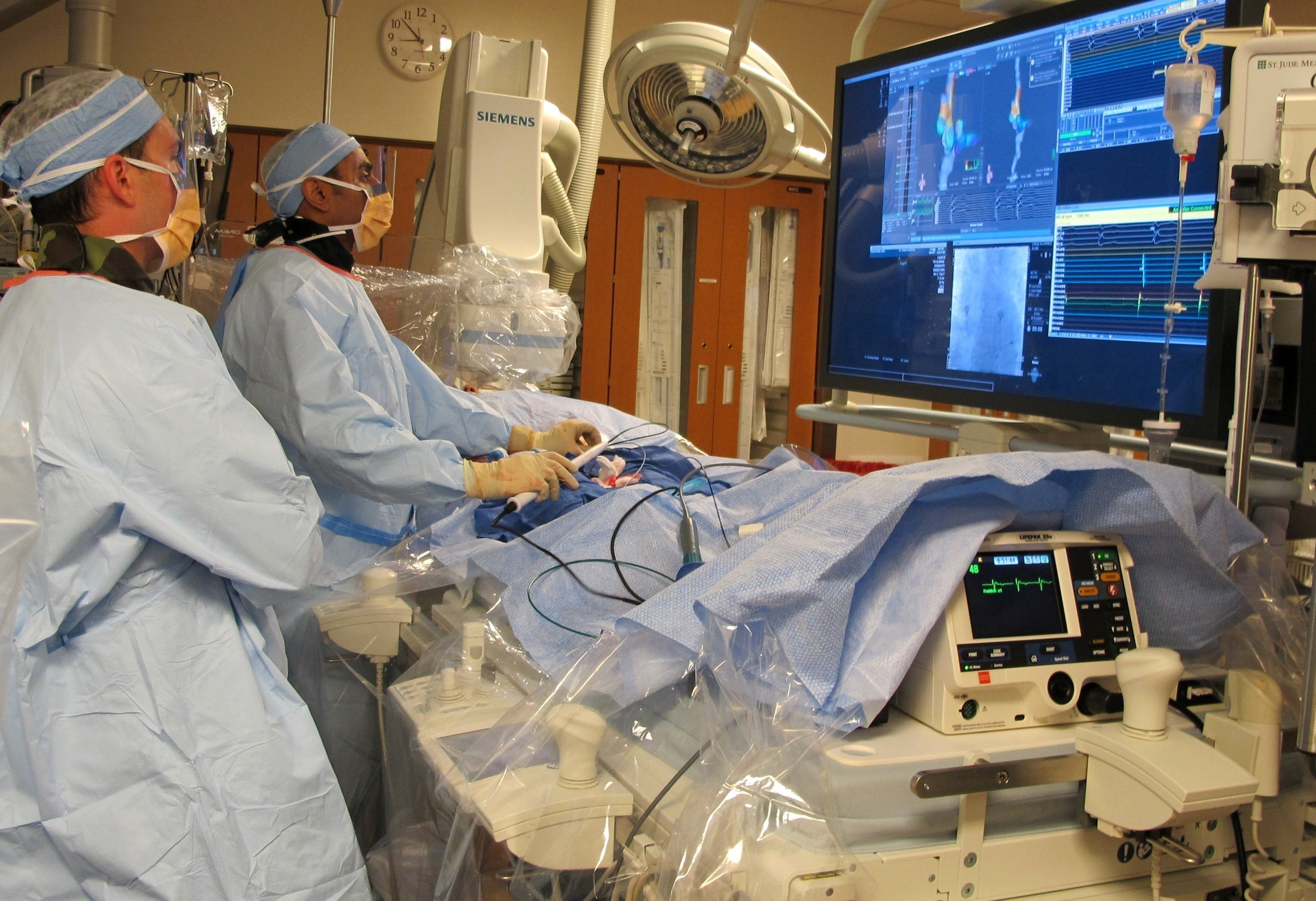 Electrophysiologist Kevin Makati, M.D., at St. Joseph's Hospital performs the first cardiac catheter ...