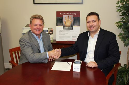 Adel Eid, CEO SBS and Carl Bertrams, SVP HT Systems sign exclusive distribution agreement for PatientSecure biometric in Middle East