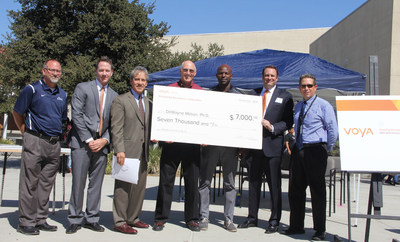 DeWayne Mason, a teacher at Patriot High School in Jurupa Valley, California, is the third place winner in the 2016 Voya Unsung Heroes awards competition. Dr. Mason is wearing red and standing in the center of the picture.