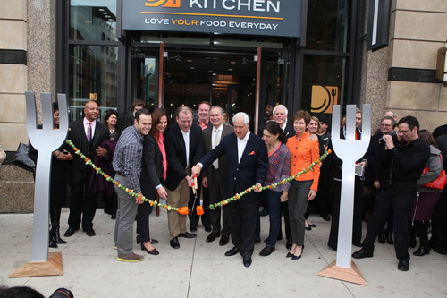 LYFE Kitchen Chicago Team with local dignitaries cut the ceremonial Brussels sprout ribbon (L to R): Nate Cooper, Gail Taggart, Alderman Brendan Reilly, Mike Donahue, Al Friedman, Carey & Cheryl Cooper, Mike & Maureen Roberts  Photo Credit: Bridget Clauson Photography.  (PRNewsFoto/LYFE Kitchen)