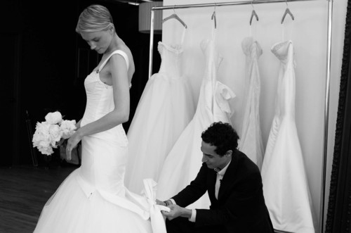 Zac Posen preparing for a photoshoot for his new Truly Zac Posen Bridal collection exclusively at David's ...