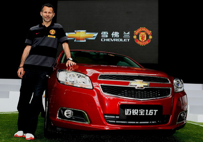 Manchester United superstar Ryan Giggs, the most decorated player in English football history and holder of the club record for competitive appearances, makes an appearance in Shanghai, China with a Chevrolet Malibu.  Global auto maker, Chevrolet is entering into a five-year partnership agreement with Barclays Premier League giant Manchester United to become the club's Official Automotive Partner. In today's announcement, Chevrolet is pledging that fans will be at the heart of its sponsorship with a constant focus on bringing the club supporters and football fans around the world closer to the game than ever before.  (PRNewsFoto/General Motors)
