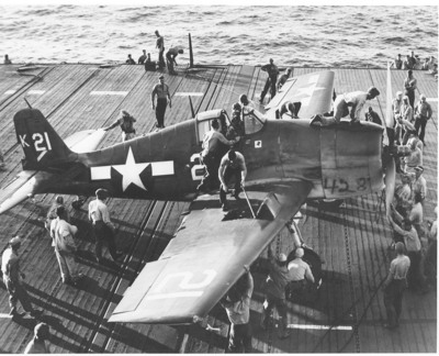 Photo courtesy of the U.S. Navy's National Museum of Naval Aviation, Pensacola, Fla. July 1944-Flight deck personnel swarm over and around an F6F-3 Hellcat of Fighting Squadron (VF) 1 after it took the barrier in a landing on board the carrier Yorktown (CV 10). This aircraft is similar to the one discovered by OceanGate.