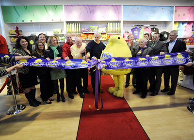 David Yale, Ross Born, David Shaffer and the PEEPS Chick are cutting the ribbon at the PEEPS & COMPANY grand opening, on Wed., Dec. 2, 2015 in Center Valley, Pa. (Michael Perez/AP Images for Just Born Quality Confections)