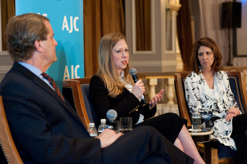 AJC Executive Director David Harris; Chelsea Clinton; Linda Mills discuss the Of Many Institute after presentation of AJC's Interfaith Leadership Award. (PRNewsFoto/American Jewish Committee)