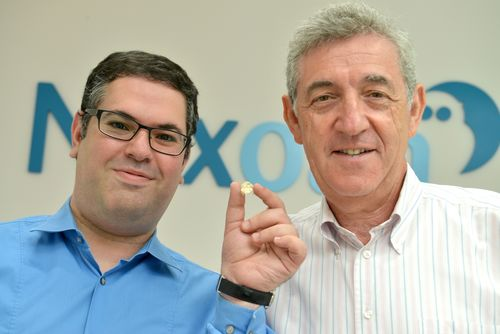 on the left – President and CEO Dr. Adi Mashiach holding Nyxoah's tiny implant, on the right – Chairman Robert Taub
