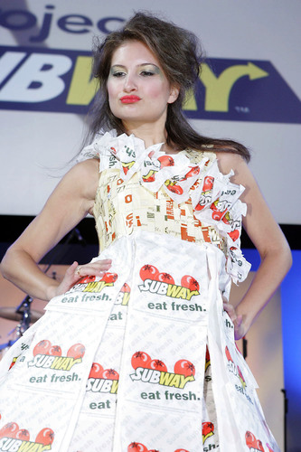 Danielle LaVoy, with the special events company, In the Loop - Chicago, models clothing created with recycled packaging used in SUBWAY(R) restaurants.  (PRNewsFoto/SUBWAY Restaurants)