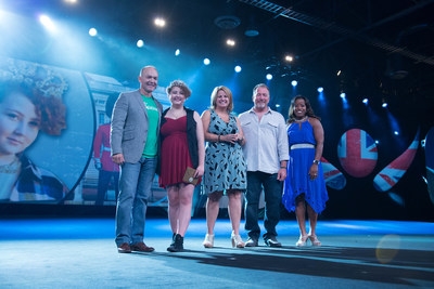 Isagenix Chief Sales and Marketing Officer, Travis Garza, Make-A-Wish and liver cancer survivor Jordyn Preston and parents Don and Beverly and Isagenix team member Elizabeth Martinsen who lost her child to cancer, celebrate the granting of Jordyn's wish - a trip to London at the company's annual 2016 Celebration event in Las Vegas.