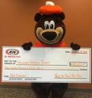 A&W Restaurants' Rooty the Bear holds a $200,000 check for Wounded Warrior Project, from donations collected during its 2014 National Root Beer Float Day. The chain collected twice the amount of last year's donations. (PRNewsFoto/A&W(R) Restaurants, Inc.)