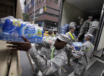 New York National Guardsman transfer bottles of Nestlé Pure Life® bottled water for distribution to New York City residents affected by Hurricane Sandy. Richard Drew, AP