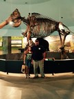 WWP Alumnus Mike Murphy and his daughter pose in front of a mastodon skeleton at the La Brea Tar Pits