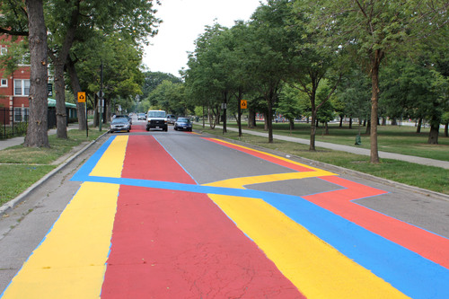 NHS of Chicago's Safe Passage street painting project in North Lawndale, completed by local artists, ...
