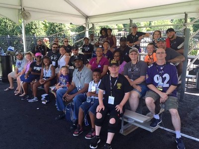 After watching the Ravens practice, veterans and family members posed for photos with players and received autographs.