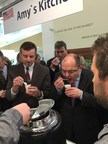U.S. Consul General in Munich Bill Mueller and German Food and Agriculture Minister Christian Schmidt enjoy American-made organic soup from Amy's Kitchen at the OTA booth at BioFach.