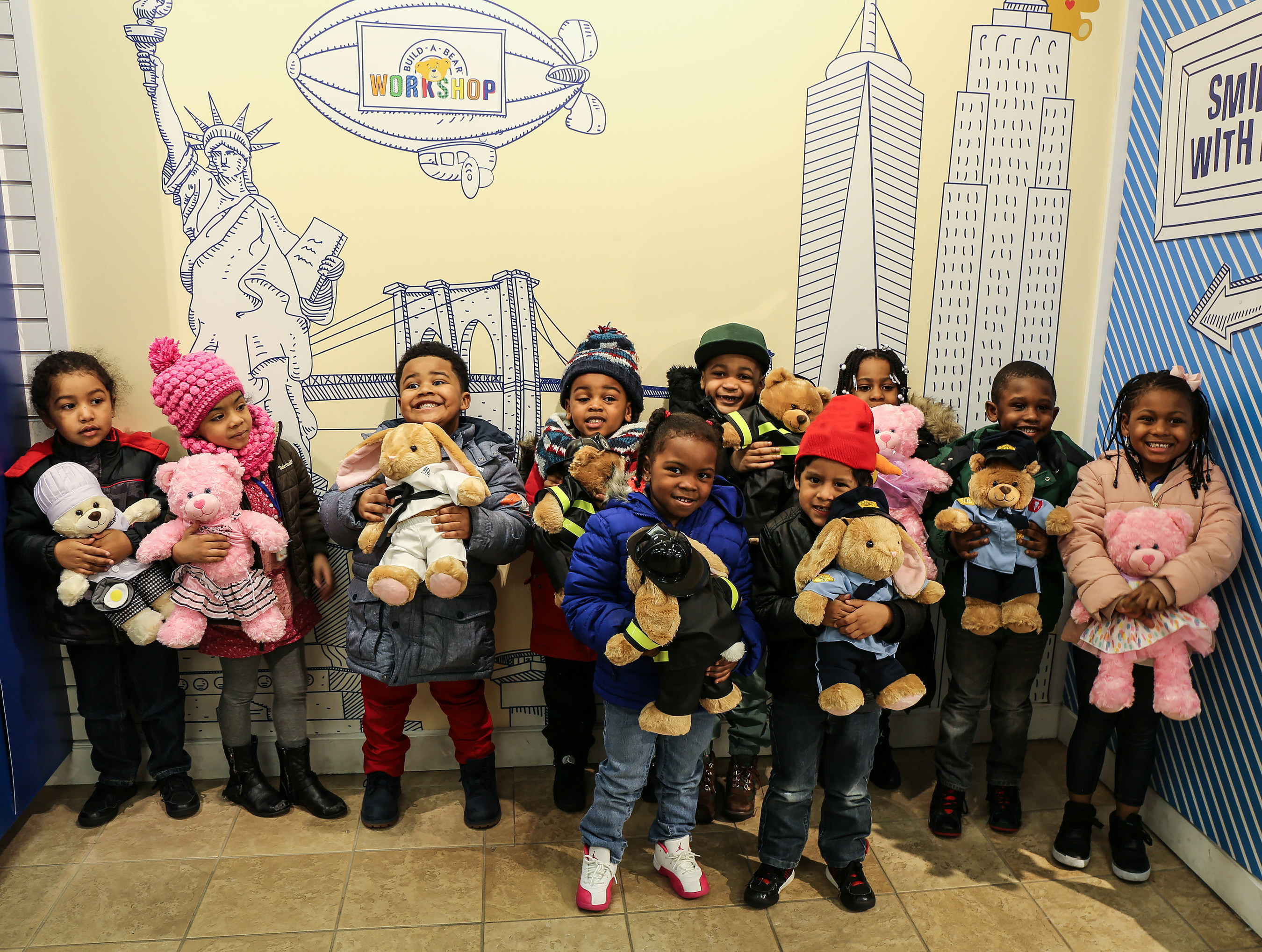 As part of Save the Children's Journey of Hope program, 25 children from Sheltering Arms Children and Family Services joined Save the Children at the Build-A-Bear Workshop Empire State Building store in New York City to celebrate the culmination of the Share Your Heart cause campaign. The Build-A-Bear Foundation matched $100,000 of guest donations to raise more than $300,000 for Save the Children's program benefitting children in need in the United States, Canada and the United Kingdom.  Photo courtesy of Save the Children.