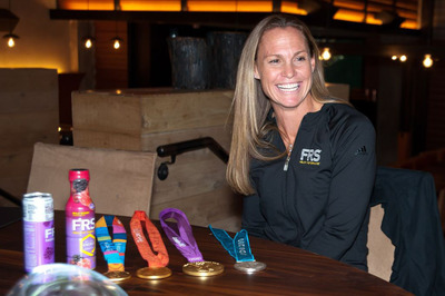USWNT Captain Christie Rampone shows off her 3rd Olympic Gold Medal at FRS Healthy Performance Event.  (PRNewsFoto/The FRS Company)