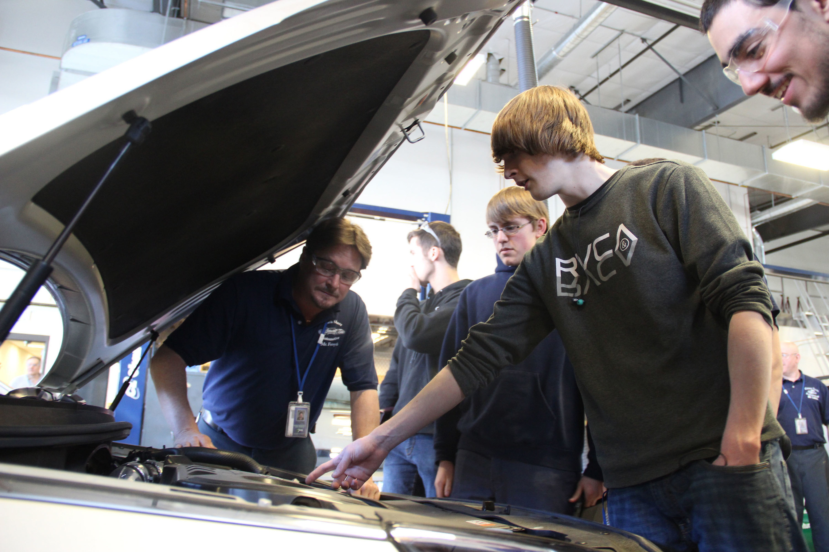Essex Tech. students interact with their new 2015 Hyundai Sonata. Essex Technical High School received a new addition to its Technology and Services Academy from Hyundai Motor America. The company donated a 2015 Sonata that will be used to train new technicians, which is extremely critical for the automotive industry. The students and faculty received the keys today. L to R in picture (Tom Forsyth (Instructor), Jason Hampton, Dante Sargent, Daniel Civinar)
