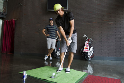 Rickie Fowler and Cameron Tringale tee off at Strip Steak & Sushi in Atlantic Station for a game of Red Bull P.A.R.  (PRNewsFoto/Red Bull, Robert Snow/Red Bull Media House)