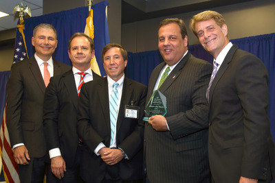 The John Theurer Cancer Center at HackensackUMC, among the nation's top 50 cancer centers, presented Governor Chris Christie with the 2013 Leadership Award on July 2. Pictured l to r: Dr. Louis M. Weiner, director, Georgetown Lombardi Comprehensive Cancer Center; Dr. Andre Goy, chairman and director, and chief of lymphoma, JTCC and chief science officer and director of research and innovation of Regional Cancer Care Associates; Dr. Andrew Pecora, chief innovations officer, professor and vice president of Cancer Services, JTCC and president of RCCA; New Jersey Governor Chris Christie; and Robert C. Garrett, president and CEO of HackensackUHN. (Photo: Hackensack University Medical Center).  (PRNewsFoto/Regional Cancer Care Associates)