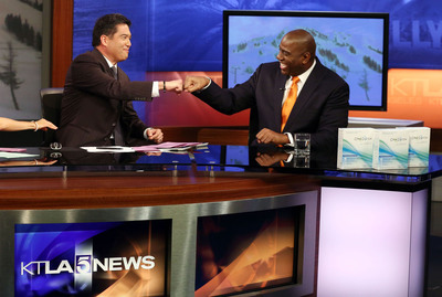 "Earvin ""Magic"" Johnson, CEO of Magic Johnson Enterprises, discusses the OraQuick(R) In-Home HIV test and the importance of knowing your HIV status with anchor Frank Buckley on the set of the KTLA Morning News Show. (PRNewsFoto/OraSure Technologies, Inc.) (PRNewsFoto/ORASURE TECHNOLOGIES, INC.)"