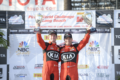 Kia Racing drivers Nic Jonsson and Mark Wilkins celebrate a double-podium finish on the Streets of Long Beach. (PRNewsFoto/Kia Motors America)