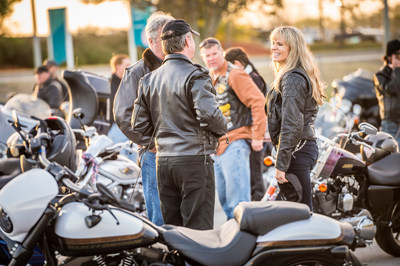 Karen Davidson, great-granddaughter of the company co-founder, interacts with military personnel and first responders before leading the group on an honorary lap around Daytona International Speedway on Thursday, March 10 in Daytona Beach, Fla., for the 75th Annual Daytona Bike Week. Throughout 2016, Harley-Davidson is offering all current and former U.S. military and first responders to learn to ride for free through Harley-Davidson's Riding Academy program.