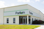 Purilum celebrates opening of new fully-automated E-liquid manufacturing, cartomizer and clearomizer filling and bottling services facility in Greenville, NC. (PRNewsFoto/Purilum, LLC)