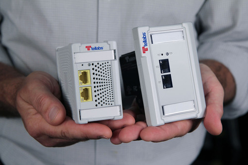 Tellabs ships the world's smallest Optical Network Terminal with power over Ethernet. Tellabs(R) 100 Series Mini ONT, the world's smallest optical network terminal (ONT) with power over Ethernet, is now available. These Mini ONTs fit neatly into offices, in a standard wall outlet or inside a cubicle raceway. The Mini ONT is part of Tellabs Optical LAN, which provides all the same features and functions as existing LANs -- while saving time, money and energy.  (PRNewsFoto/Tellabs)