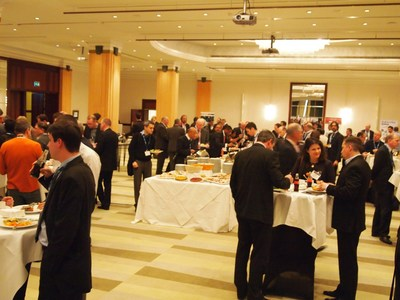 Attendees at last year's Unmanned Systems Europe Conference participate in a catered networking session.