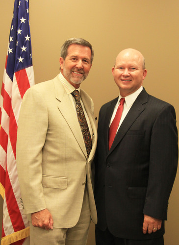 U.S. Congressman John Campbell (left) awards NuVision Federal Credit Union CEO Roger Ballard (right) special ...