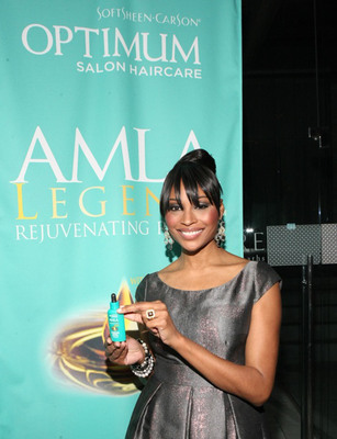 Cynthia Bailey with AMLA Legend Billion Hair Potion.