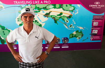 Rickie Fowler stands in front of the Crowne Plaza Invitational at Colonial travel wall. (PRNewsFoto/InterContinental Hotels Group)
