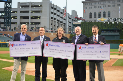 Ilitch Charities, a non-profit organization affiliated with Detroit entrepreneurs Michael and Marian Ilitch, donated $150,000 in grants to three prominent southeast Michigan charitable groups: the Detroit Historical Society, the Michigan Humane Society and the Macomb-Oakland Regional Center. The grant presentation took place on September 20 at Comerica Park prior to the Detroit Tigers vs. Chicago White Sox game.  (PRNewsFoto/Ilitch Charities)