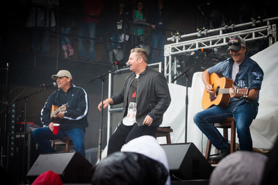 Rascal Flatts' Gary LeVox (middle) performs on stage with songwriters, Neil Thrasher (left) and Kelley Lovelace (right) during Sunday night's performance at Tree Town Music Festival in Forest City, Iowa.