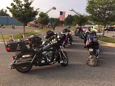 Motorcycles are lined up for the Second Annual Ride with the Heroes. A group of injured veterans with Wounded Warrior Project escorted hundreds of motorcycle riders across Maryland on a 65-mile rural tour. The ride is an annual community event that recognizes service members including military, firefighters, and police.
