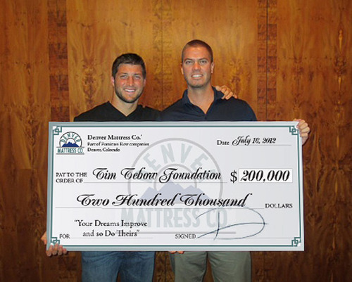Denver Mattress Donates $200,000 to the Tim Tebow Foundation to Help Orphans in the United States and Around the World. Tim Tebow / NFL Quarterback and Dan Visser / President Denver Mattress Company.  (PRNewsFoto/Denver Mattress Company)