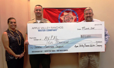 Ranchos Water Apple Valley Ranchos Water Co. General Manager and Vice President presents Apple Valley Police Activities League with donation.  (PRNewsFoto/Apple Valley Ranchos Water Company)