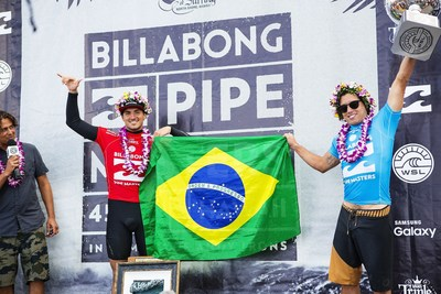 Gabriel Medina (left) celebrates the 2015 WSL Title clinching by compatriot Adriano de Souza (right) at the Billabong Pipe Masters in Memory of Andy Irons. In addition to claiming the 2015 WSL Title, De Souza made history as the first Brazilian to win the Pipe Masters while Medina, the 2014 WSL Champion, made history as the first Brazilian Vans Triple Crown winner.