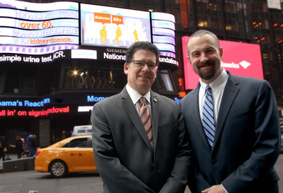 Raising awareness of kidney disease and the importance of urine testing, Bruce Skyer, CEO, National Kidney Foundation (NKF) and David Stein, CEO, Point of Care Business Unit, Siemens Healthcare, Diagnostics Division stand in front of the ABC Super Sign in Times Square, NYC.