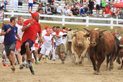 The Great Bull Run draws thousands of thrill-seeking participants, held in select cities across the U.S.  (PRNewsFoto/The Great Bull Run)
