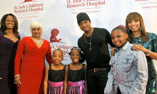 Loraine Smith, Aliyah Najm, Grammy award winning artist Ne-Yo, and actress Elise Neal pose with St. Jude patients Felecia, age 7, Jayla, age 8, and JJ, age 12 on the red carpet at the inaugural St. Jude Soul Celebration at the J.W. Marriott in Buckhead.  (PRNewsFoto/St. Jude Children's Research Hospital)