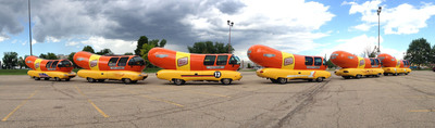 Six teams of Hotdoggers and their newly personalized Wienermobile vehicles are asking fans where and how they'd like to see the Wienermobile this summer to help them earn points, give away swag, and ultimately be named Champion.  (PRNewsFoto/Oscar Mayer)