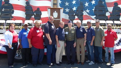 "C.R. England has added six additional drivers to its Honored Veterans Fleet and recognized World War II-era veteran Colonel Gail S. Halvorsen USAF (Ret) ""The Berlin Candy Bomber"" as the first recipient of the first C.R. England Honored Veteran Award. Pictured left to right: Katie Freisen,Senior Director, Global Distribution & Transportation - The Hersey Company; Drivers Mark Evans, Robert St. John, and Brian Walk; Dan England C.R England Chairman; Colonel Gail S. Halvorsen USAF (Ret); Gene England, C.R. England President Emeritus;  Drivers Tim Williams, Leland Boyles and Dennis Hallowell."