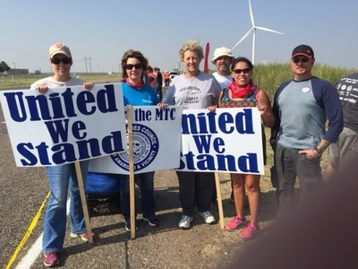 Members of the Office and Professional Employees International Union (OPEIU), AFL-CIO, on the picket line against Consolidated Nuclear Security (CNS) at Pantex are, left to right, Lori McCoy, Kerri Gilley, Pam George, Paul Owen, Jessica Cavasos and James Houser.