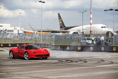 Sebastian Vettel wows the crowd in a driving spectacular (PRNewsFoto/UPS) (PRNewsFoto/UPS)