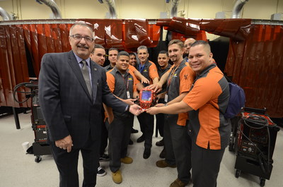 FTC President David Ruggieri, left, with members of the college's first Construction Trade and Technology program.